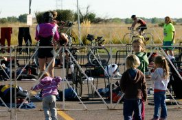 That is my youngest daughter trying to sneak into the transition area as I trasition from the swim to the bike.